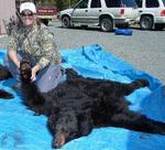 Corey with a Price William Sound black bear taken in June, 2003.