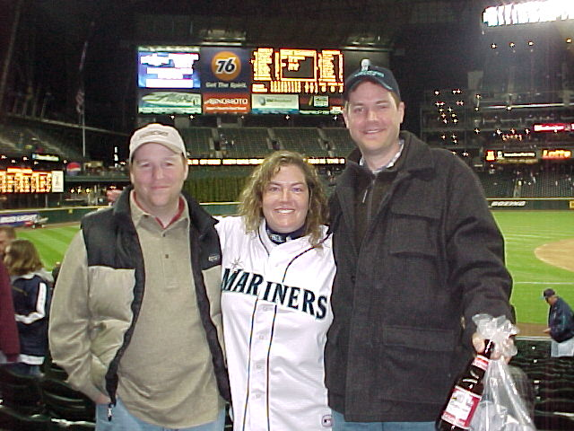 Corey and our pals Joe and Kent enjoying an M's game ... now off to the Claimjumper!