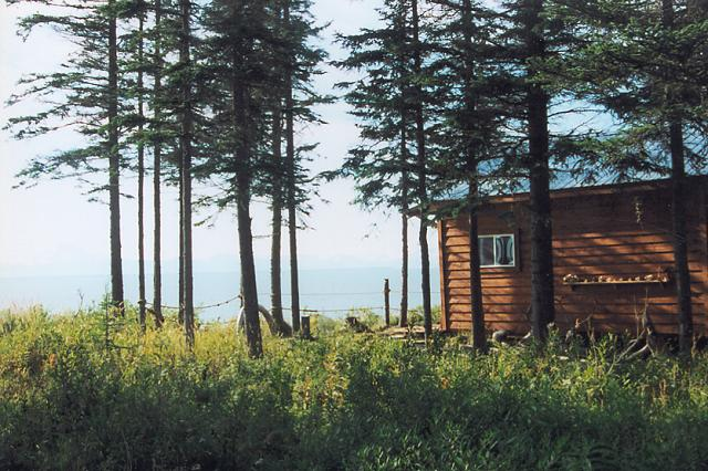 An exterior view of the cabin at Ocean Bluff overlooking Cook Inlet and the numerous volcanic peaks to 10,000+ feet on it's far