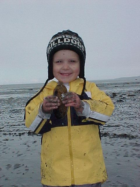 A young digger shows off his prized raor clam!