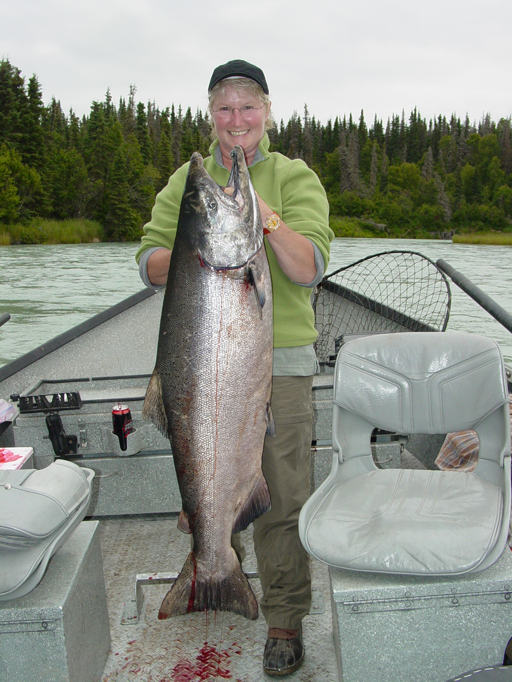 Mrs. C shows off one of her many Kasilof kings she's caught over the years.