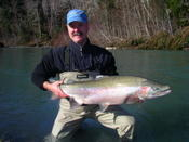 Michael N. with a mssive Hoh River steelhead.