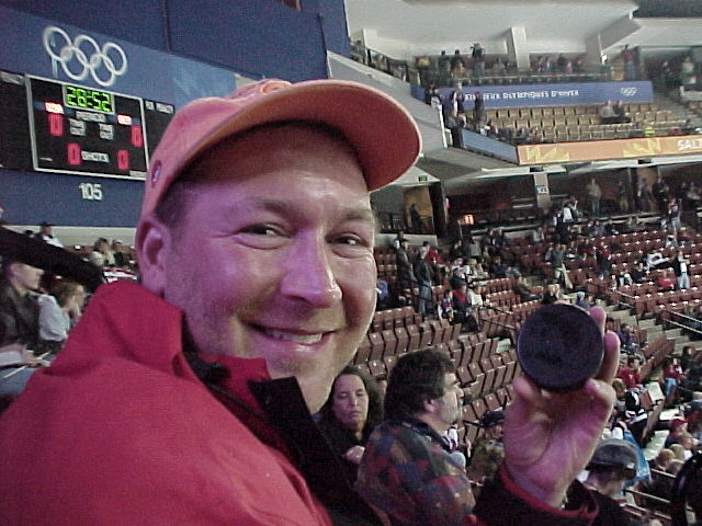 Bob gets a rare souvenir at the 2002 Salt Lake City Olympics ... a puck that made it over the boards during the USA / Germany ho