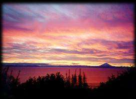 Sunset over Alaska's Cook Inlet just south of the Kenai River.
